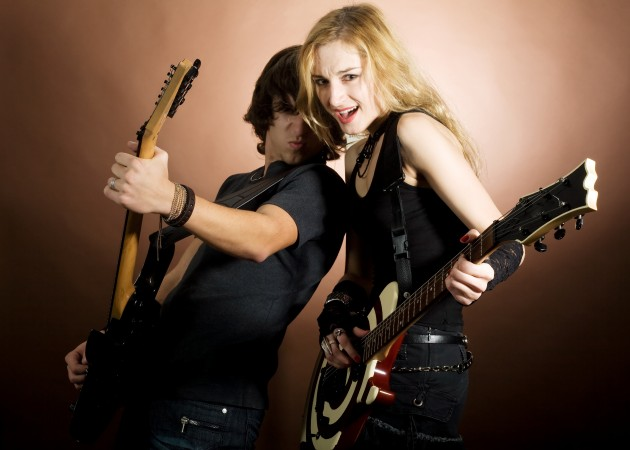 An image of girl and boy with guitars